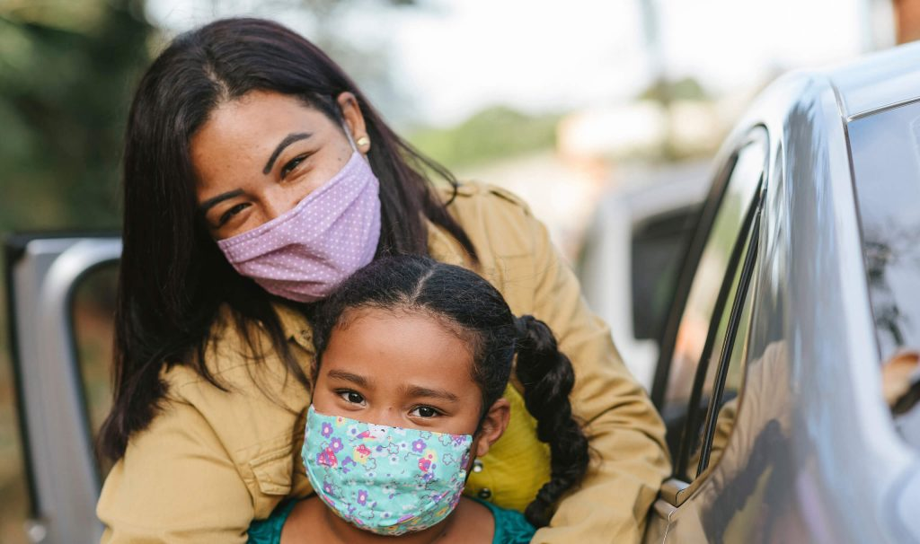 mom and daughter wearing masks